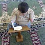 طفل  معوق يقرا القرآن4