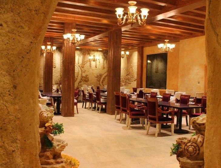 مطاعم الكهف Size:159.30 Kb Dim: 729 x 557